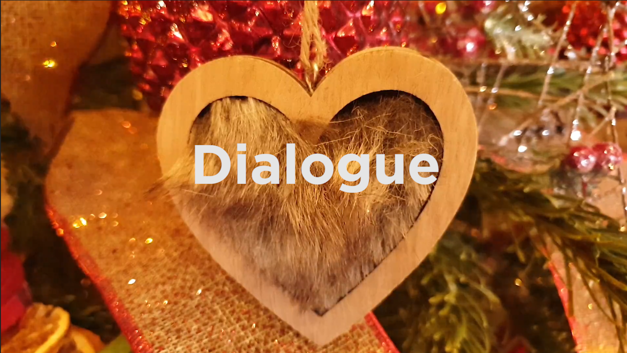 Heart bauble on Xmas tree with word 'Dialogue' inside